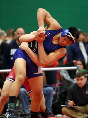 From right, Edgemont's Clifton Wang was defeated by Hilton's Louie Deprez in the semifinals of the 182-pound weight class during the Eastern States Classic Wrestling Tournament at Sullivan Community College in Loch Sheldrake, N.Y. Jan. 14, 2017.