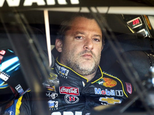 Driver Tony Stewart sits in his car during practice for the NASCAR Sprint Cup auto race at New Hampshire Motor Speedway, Friday, Sept. 19, 2014, Loudon, N.H.