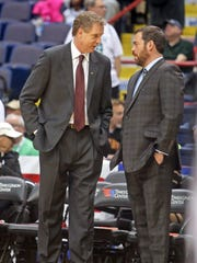 Iona coach Tim Cluess and Manhattan coach Steve Masiello talk before the two teams played in the MAAC Championship game at the Times-Union Center in Albany March 9, 2015. Manhattan defeated Iona 79-69 to advance to the NCAA tournament.