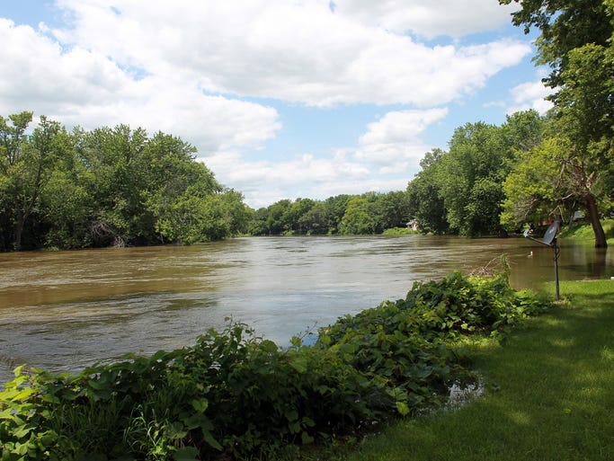 The Iowa River flows along River Bend Road on Thursday, July 3, 2014. David Scrivner / Iowa City Press-Citizen