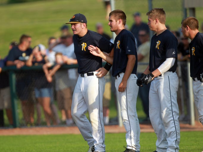 Regina players are introduced before their game against Louisa-Muscatine at Solon on Tuesday, July 22, 2014. David Scrivner / Iowa City Press-Citizen