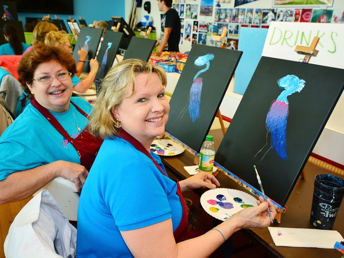 Jann Mills an Kris White at the Blue Wahoos Women's Club Painting with a Twist night. For more stories and photos, see the July