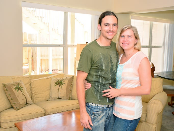 """Matt and Salina in the living room of their beachfront bargain home as seen on HGTV.<br /> For this story and more home and garden ideas, see the July issue of Pensacola Home & Garden, and go to <a href=""""http://www.PensacolaHG.com"""">www.PensacolaHG.com</a>."""