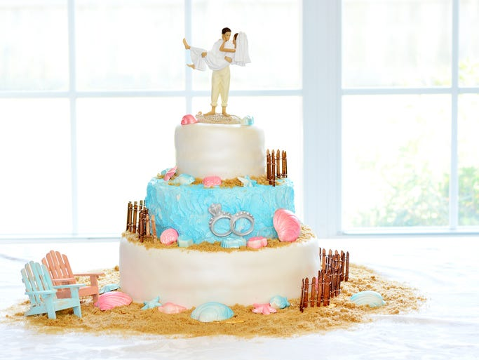 A beach themed wedding cake by Julonda Carter at JC Creations.For this story and more stories and photos, see the Bella Bride Fall magazine, and go to www.BellaMagazine.com.