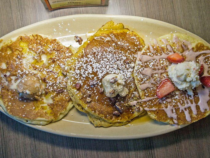 Pancake flight with: pineapple upside down pancake, sweet potato pancake and strawberry malted pancake from Snooze, an A.M. Eatery.