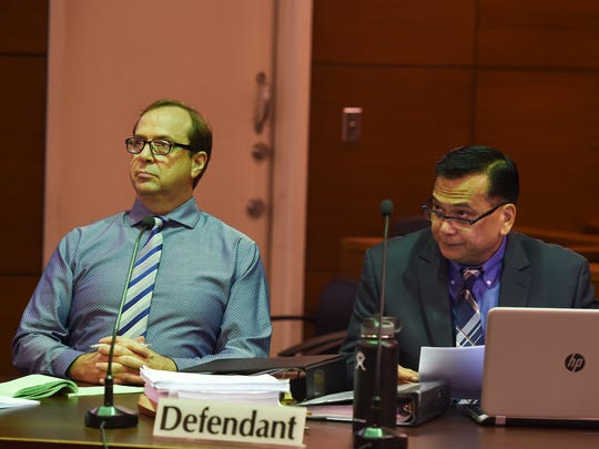 "University of Guam professor Michael B. Ehlert, left, with his defense attorney Joaquin ""Jay"" Arriola, during his sexual assault trial at the Superior Court of Guam on July 17, 2017."