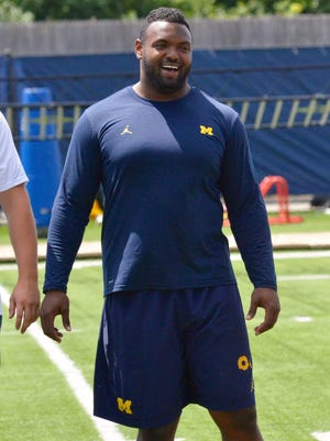 Michigan defensive lineman Maurice Hurst looks on as the U-M football team and AS Roma work out on Monday, July 17, 2017, in Ann Arbor.