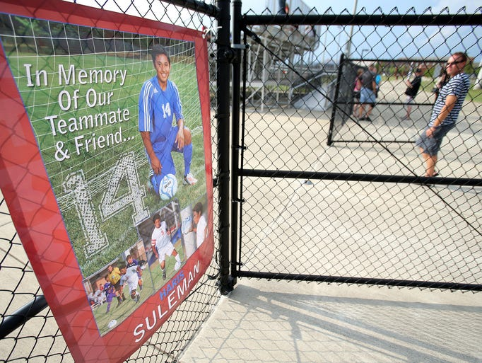 A banner is outside the stands as a memorial for classmate Haris Suleman before the Plainfield varsity soccer game against Cardinal Ritter, on Tuesday, August 19, 2014, in Plainfield.