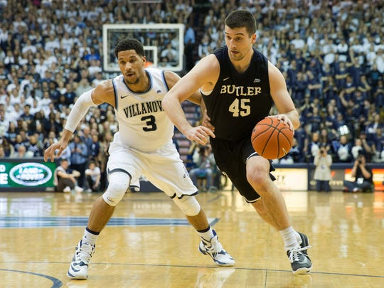 Butler Bulldogs forward Andrew Chrabascz (45) dribbled against Villanova Wildcats guard Josh Hart (3) during a game at The Pavilion.