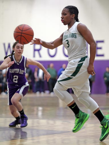 Woodlands' Imani Tilford (3) dribbles past the Hampton Bays' Mackenzie Tyler (2) in the Class B girls basketball regional finals at New Rochelle High School on March 8, 2014. Woodlands defeated Hampton Bays 57-42.