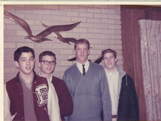 A photo taken around Christmas 1964 of Mike Adair, Mark Morden, Roddy Henderson, Bruce Berridge. Three of the teens were in a horrific car crash three weeks after the photo was taken.