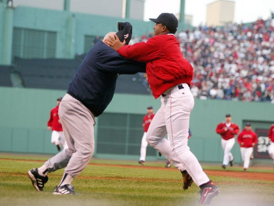 In this Oct. 11, 2003 file photo, Boston Red Sox pitcher Pedro Martinez, right, grabs New York Yankees coach Don Zimmer by the head before throwing him to the ground.