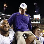 LSU head coach Les Miles is carried off the field after a win over Texas A&M.