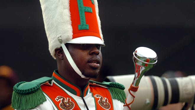 Robert Champion, a drum major in Florida A&M University's Marching 100 band, performing during halftime of a football game in Orlando, Fla., on Nov. 19, 2011, just hours before he died after a brutal hazing ritual.
