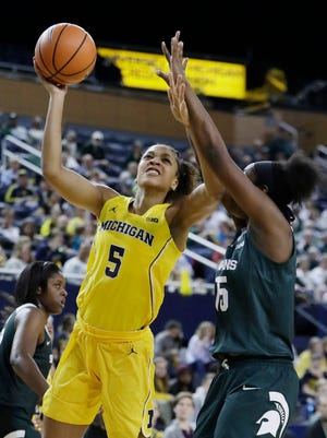 Michigan forward Kayla Robbins (5) shoots over Michigan State forward Victoria Gaines (15) during the second half of U-M's 74-48 win over MSU on Tuesday, Jan. 23, 2018, at Crisler Center.