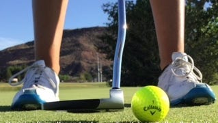 Hovering the putter and not grounding it doesn't allow the hands to re-grip and change grip pressure when starting the backswing.