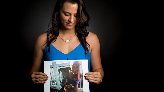 Enquirer higher education reporter Kate Murphy, holds a photo of her late friend, Colie Dennion. Murphy will host the next edition of Cincy Storytellers about growing up on June 8.