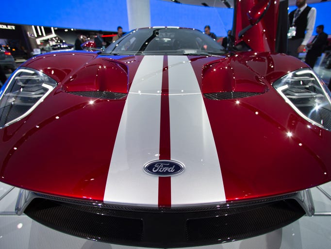 A front bonnet view of a Ford GT supercar on display