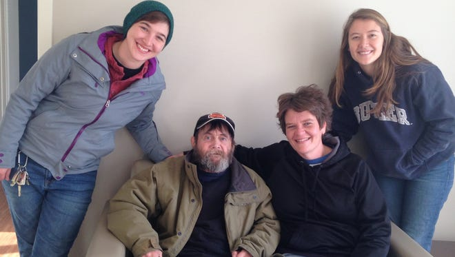 Tommy Young is surrounded by people who helped him move into Penn Place earlier this year. From left are caseworker  Kelsey Kennedy and outreach workers Melissa Burgess and Kathleen Brannen. Young died in his apartment at Penn Place.