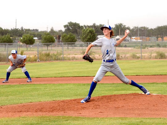 Carlsbad's Gaige Madron fires a pitch in the bottom