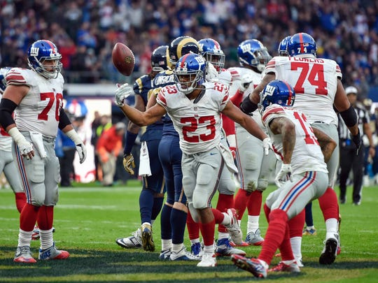 Steve Flynn-USA TODAY Sports Giants running back Rashad Jennings (23) celebrates his decisive fourth-quarter touchdown against the Los Angeles Rams on Sunday at Twickenham Stadium in London. Oct 23, 2016; London, ENG;  Running back Rashad Jennings (23) of the New York Giants celebrates his 4th quarter winning touchdown during the game between the Los Angeles Rams and the New York Giants at Twickenham Stadium. Mandatory Credit: Steve Flynn-USA TODAY Sports