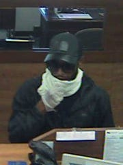 A surveillance photo released by Yorktown police shows a suspect in a bank robbery there Thursday.