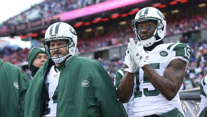 Ryan Fitzpatrick #14 of the New York Jets and Brandon Marshall #15 of the New York Jets watch the game against the Buffalo Bills from the sidelines during the first half at Ralph Wilson Stadium on January 3, 2016 in Orchard Park, New York.
