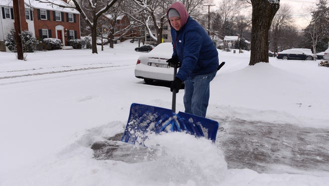 Chris Huebner shovels snow from his driveway in Bethesda, Md.