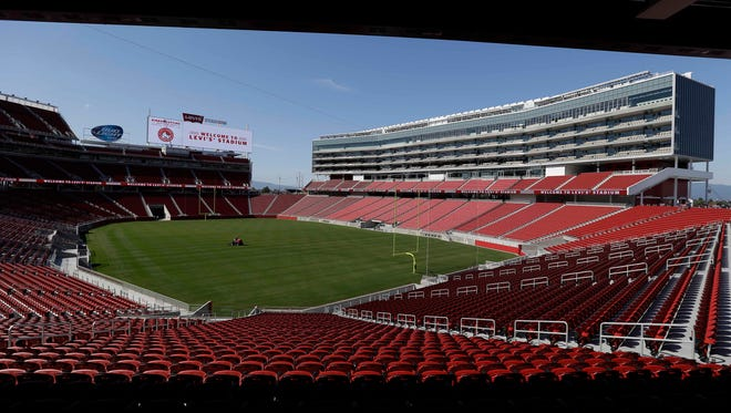 A groundskeeper drives across the field before the ribbon-cutting and opening of Levi's Stadium in Santa Clara, Calif. With the climate ripe for commerce, local organizers think they can make a strong case to bring the 2024 Olympics to the San Francisco Bay Area.