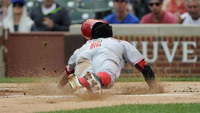 Cincinnati Reds center fielder Billy Hamilton (6) scores against the Chicago Cubs in the first inning at Wrigley Field.