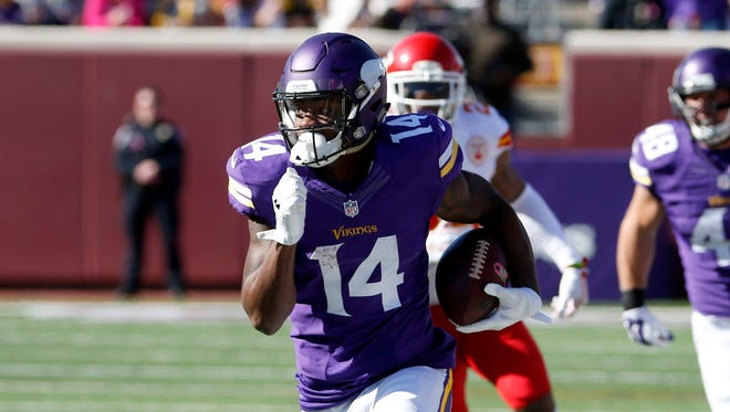 In this Oct. 18, 2015, file photo, Minnesota Vikings wide receiver Stefon Diggs (14) runs with the ball during the first half of an NFL football game against the Kansas City Chiefs, in Minneapolis.