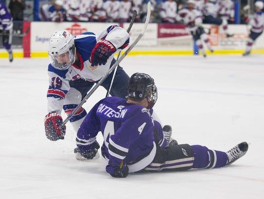 NTDP U-18 player Clayton Keller (No. 19) tries to avoid