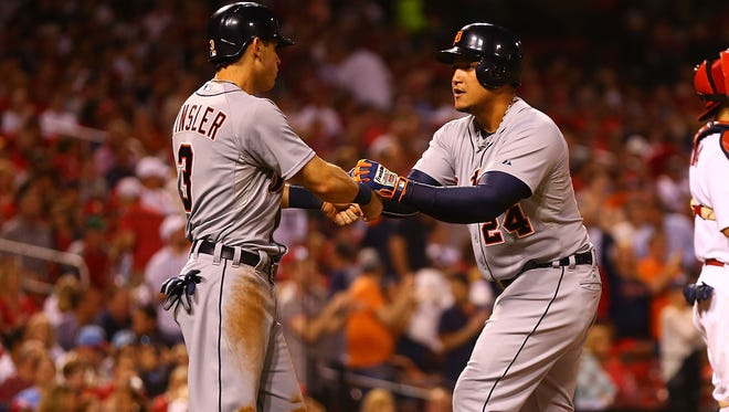 Tigers second baseman Ian Kinsler congratulates first baseman Miguel Cabrera after Cabrera hit a two-run home run in the seventh inning tonight at Busch Stadium.