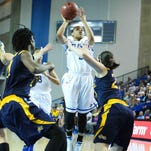 UD forward Alecia Bell dribbles around Drexel guard Fiona Flanagan during the Hens' home setback Sunday.