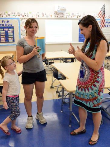 Britni Danec, right, a kindergarten teacher at Tallmadge