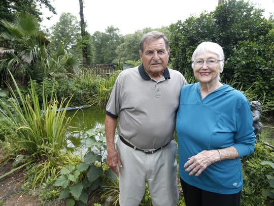 Former Florida State football coach Darrell Mudra and his wife Jean stand outside their home in Crawfordville.