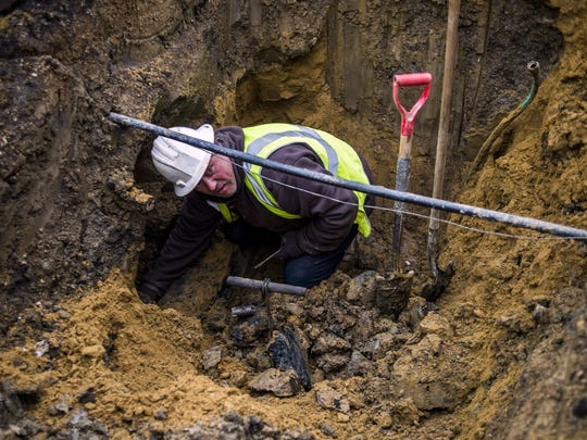 Michigan officials are questioning if crews digging water service lines in Flint near an American Indian burial ground found human remains after an inspector found work was being conducted without an archaeologist.