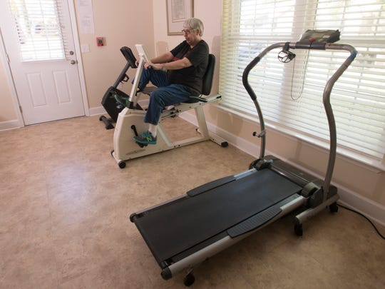 Nancy stays fit using the in house fitness equipment.