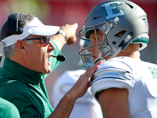 Head coach Chris Creighton of the Eastern Michigan Eagles talks with his quarterback Brogan Roback (4) against the Rutgers Scarlet Knights during the first quarter of a game on September 9, 2017 in Piscataway, New Jersey.