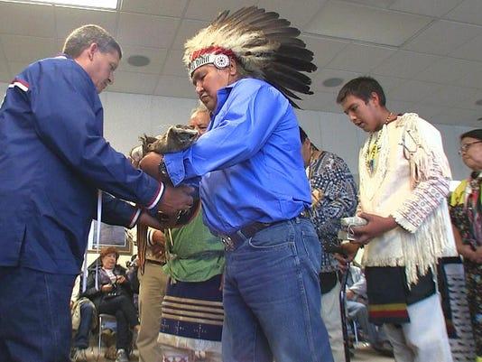 -bill morin completes handing of pipe bundle to gerald gray jr bill morin i.jpg