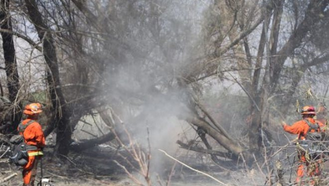 Firefighters worked to contain a Thermal vegetation fire for four days before declaring it 95 percent contained.