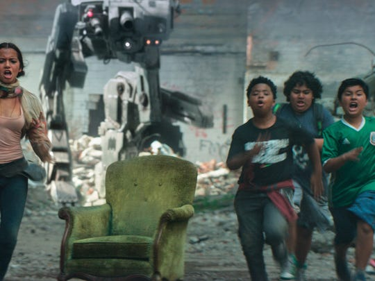 "Benjamin ""Lil P-Nut"" Flores Jr. (third from left) tries to outrun a robot in ""Transformers: The Last Knight."" He's joined by (from left) Isabela Moner, Juliocesar Chavez and Daniel Iturriaga."
