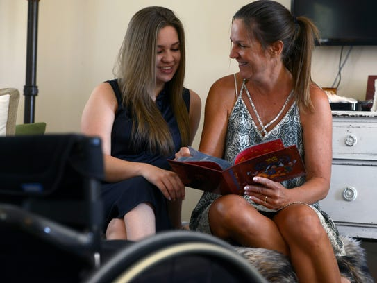 Emma Dinsmore and her mom Martina Mathis look through