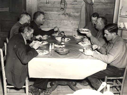 bear-hunters-at-evening-meal-AC-T-1950.jpg
