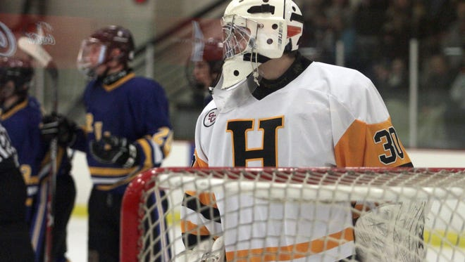 Hendersonville goalie Brandon Shaw watches as Brentwood celebrates a score on Wed. Feb. 28, 2018.  Photo by Dave Cardaciotto