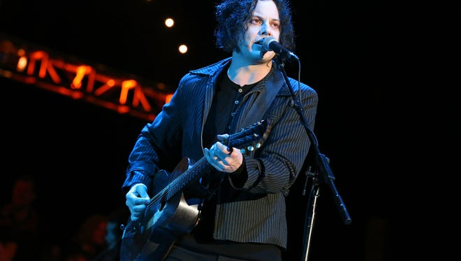 "FILE - This Oct. 20, 2012 file photo shows Jack White performing at the Bridge School Benefit Concert in Mountain View, Calif. White is going direct to vinyl with the first live performance of a song off his upcoming album on Record Store Day. Fans will get to see him perform the title track from ""Lazaretto"" on Saturday morning, which will be recorded and pressed into a limited edition vinyl record that afternoon. (Photo by Barry Brecheisen/Invision/AP, FIle)"