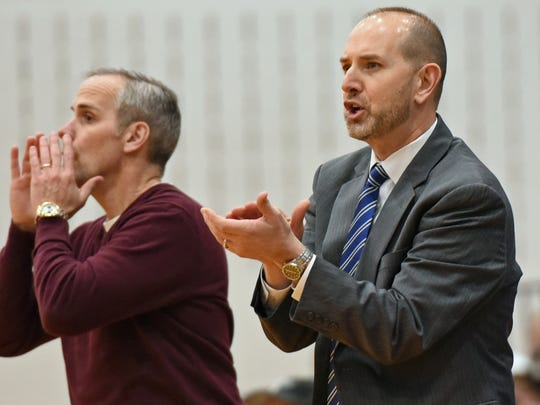 Shawn Shreffler, fright, and assistant Randy Taylor coach the Central Dauphin game. Chambersburg battled Central Dauphin during the District 3 Class 6A first round boys basketball playoff game. Panthers won 76-59.