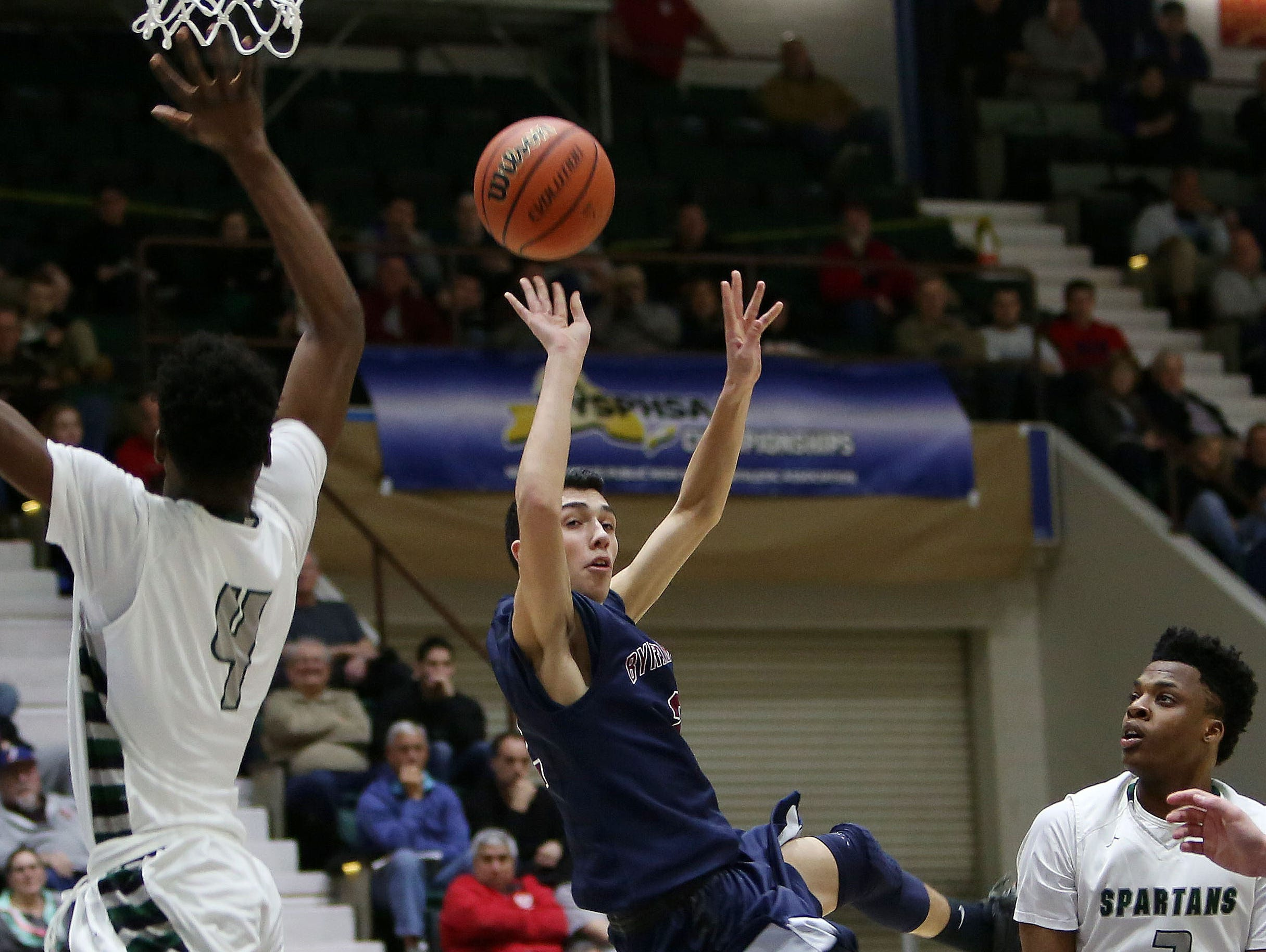 Byram Hills' Skylar Sinon (2) has his path to the basket blocked by a host of Elmont defenders during the New York State boys basketball Class A semifinal game at the Glens Falls Civic Center March 12, 2016. Element won the game 50-48.