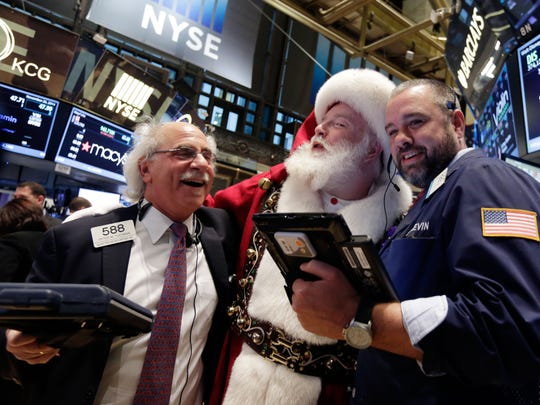 Traders Peter Tuchman, left, and Kevin Lodewick pose