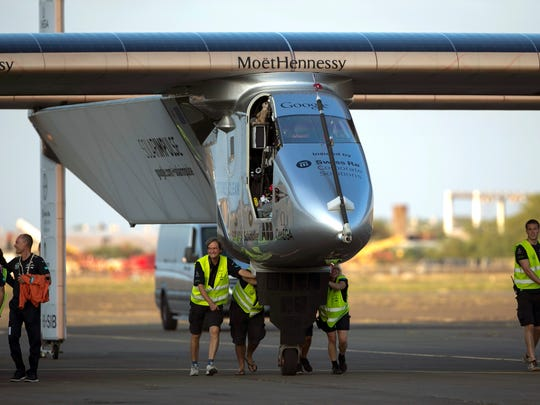 Ground crew push the Solar Impulse 2, a solar powered